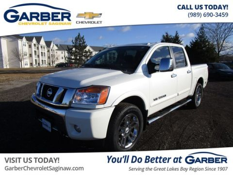Pre-Owned 2015 Nissan Titan SL 4WD